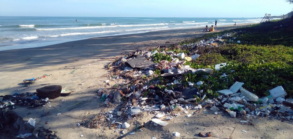 pollution on a beach after tourists visits
