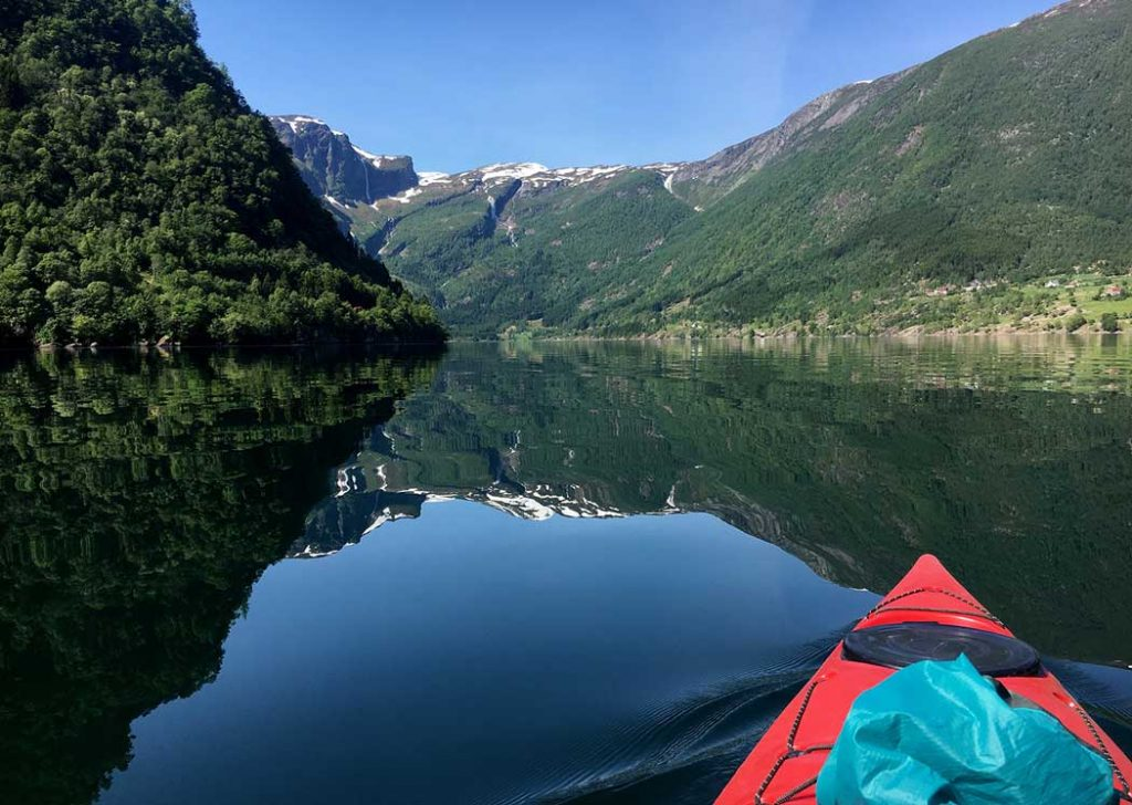 calm fjord with kayak